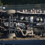 semi truck accident rolled