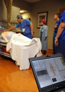 SAN DIEGO (Oct. 13, 2010) A laptop is used to control a training mannequin's vital signs during a mock code blue drill at the pain management clinic at Naval Medical Center San Diego. Mannequins offer health care providers the opportunity to practice using simulated patients and sophisticated technology. (U.S. Navy Photo by Mass Communication Specialist 1st Class Anastasia Puscian/Released)